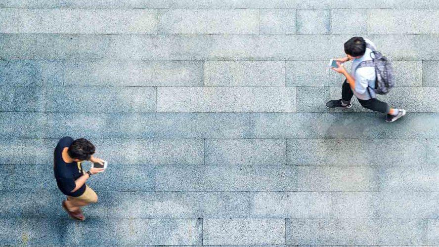 people walking mobile phone