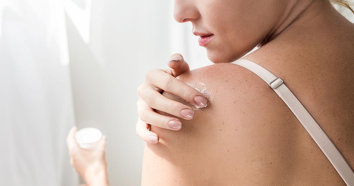 woman applying cream maple