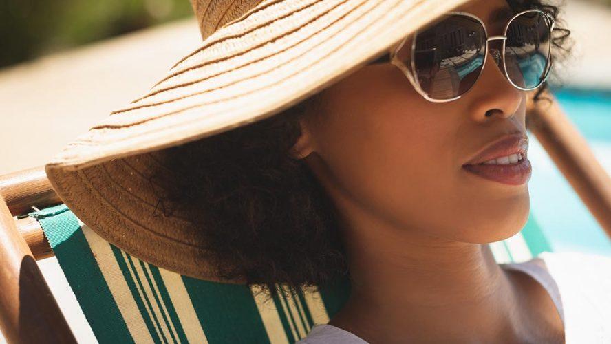 woman sunbathing with cap