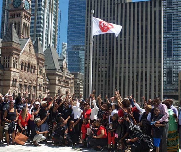 sickle cell people pointing flag