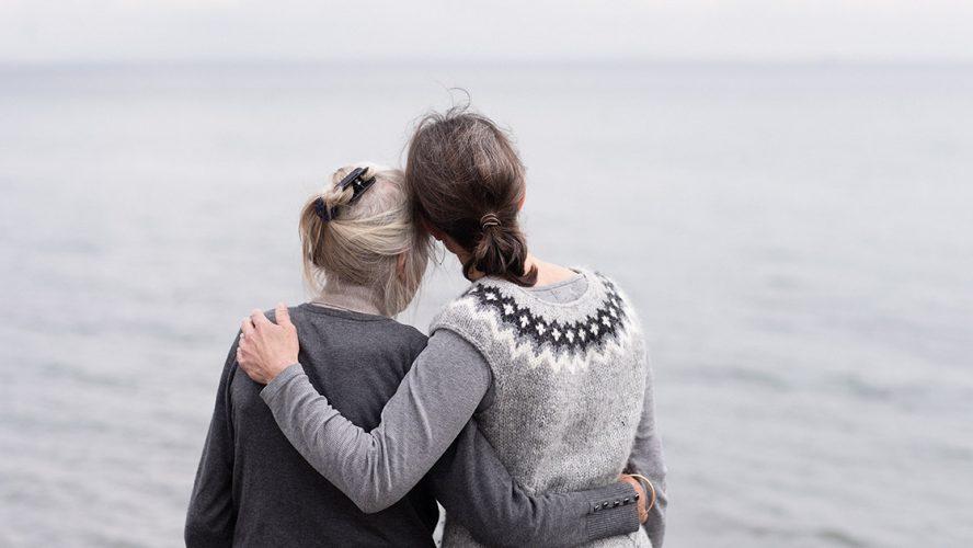 women gazing ocean