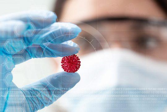 moderna scientist examining mrna vaccine