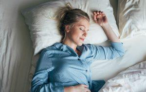 woman sleeping bed sleep health