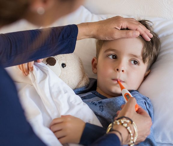 young boy sick thermometer immunize canada