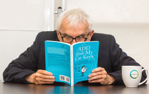 "Photo of Rick Green reading the book ""ADHD Stole My Car Keys"""