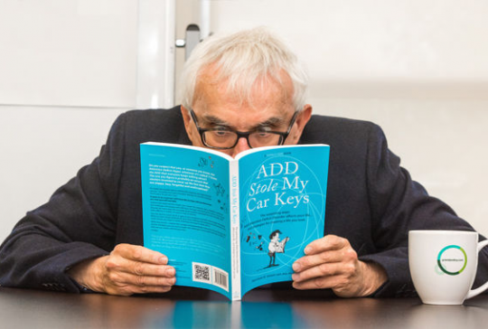 "Photo of Rick Green reading the book ""ADHD Stole My Car Keys"""