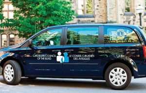 A photograph one of the Canadian Council for the Blind's Mobile Eye Clinic minivans.