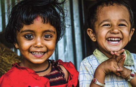 Two smiling young girls in South Asia