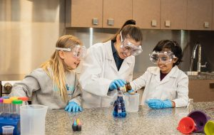 Three girls enjoying a science experiment