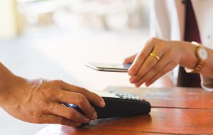 Customer paying for service with their mobile phone