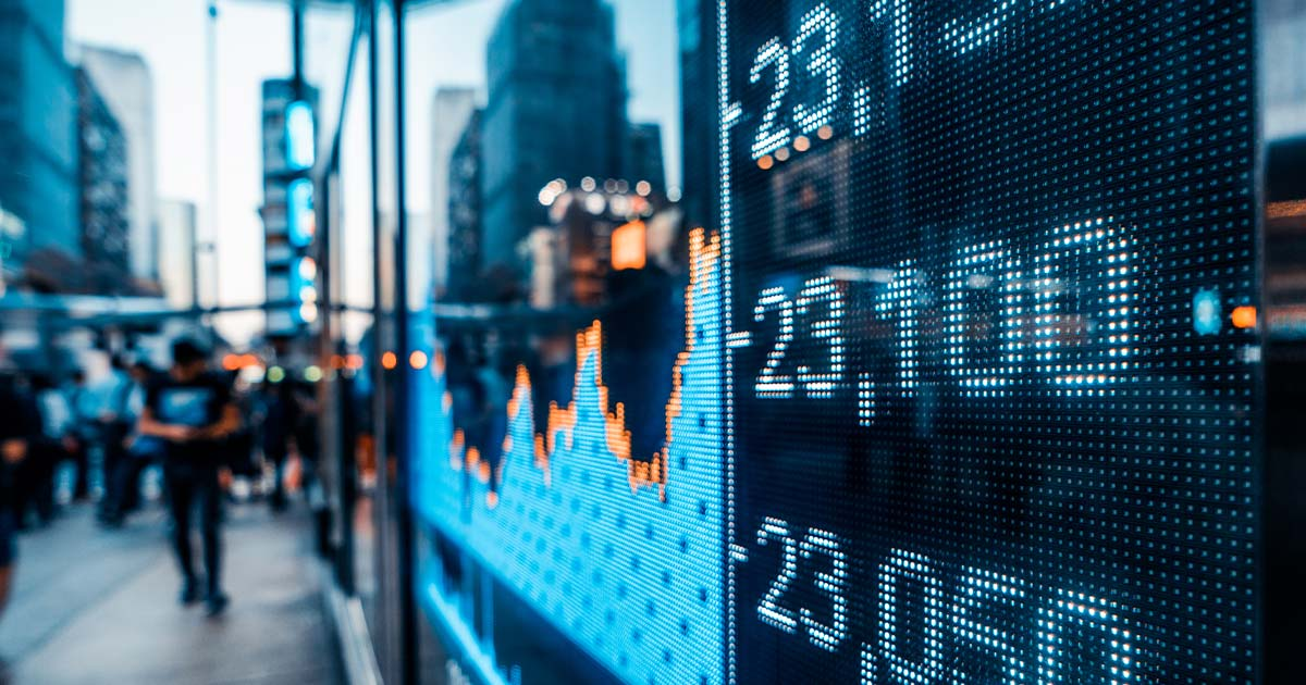 Stock market ticker on a busy street