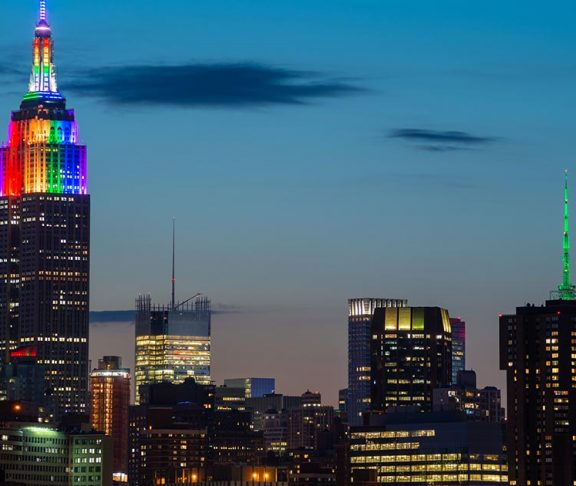 The Empire State Building lit up with a Pride rainbow