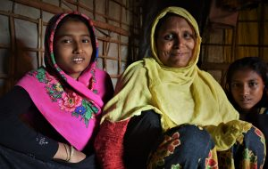 Rohingya refugee Ayesha with her daughters in her shelter in the camps in Cox's Bazar, Bangladesh.