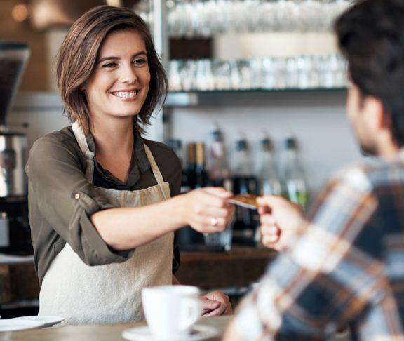 Barista happy to take customer's card for payment