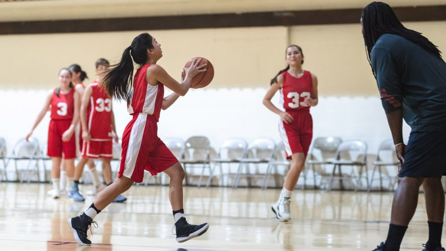Girl playing in basketball league
