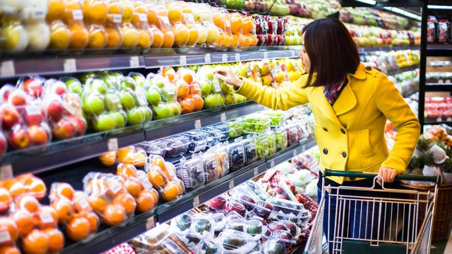 Woman choosing produce at the grocery store