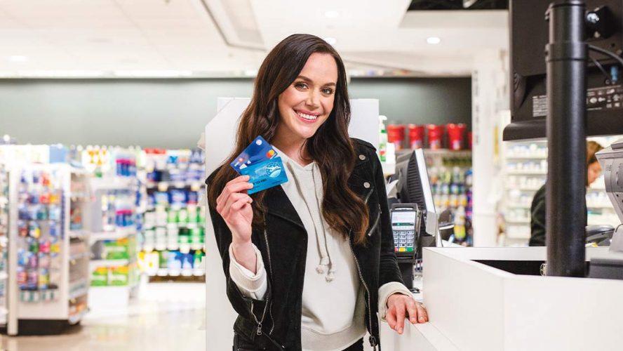 AIR MILES customer holding reward cards