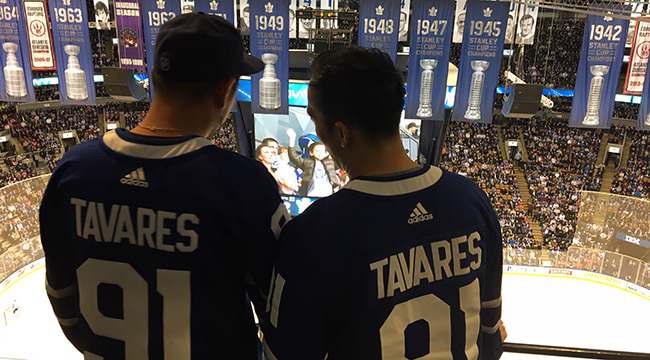 Two Tavares fans at a Leafs game