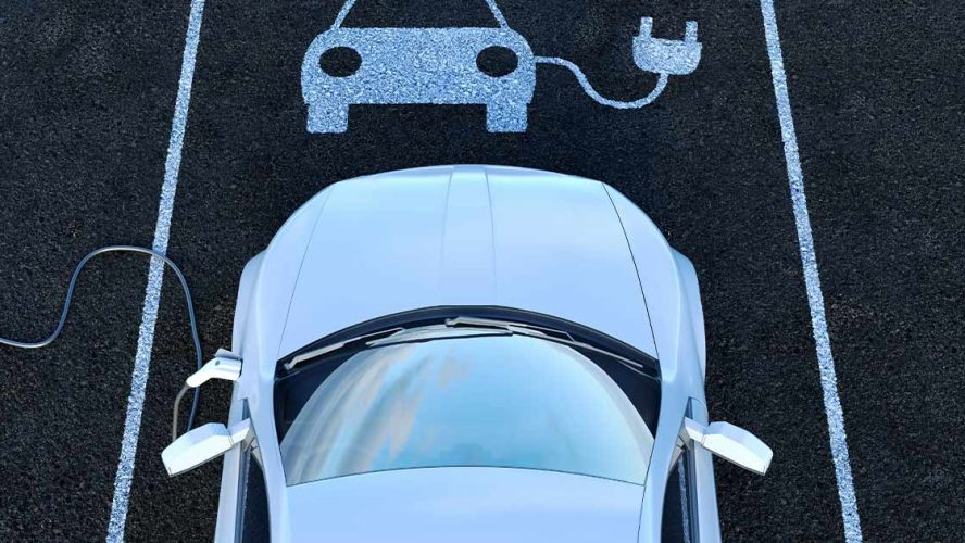 Aerial view of a charging electric car