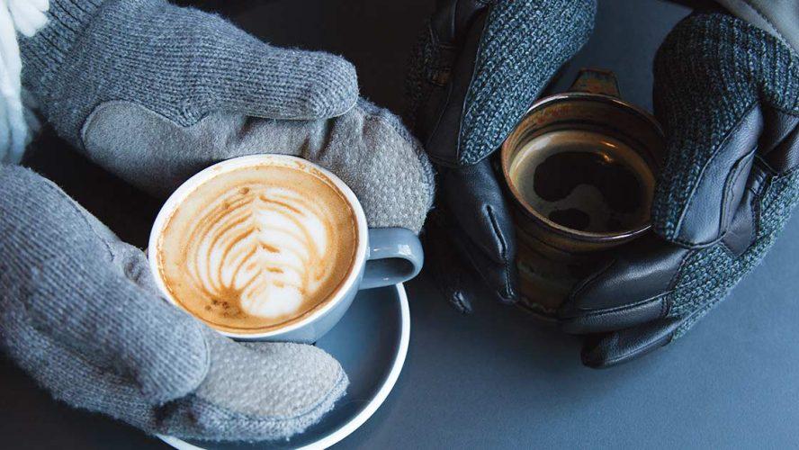 Gloved hands holding lattes