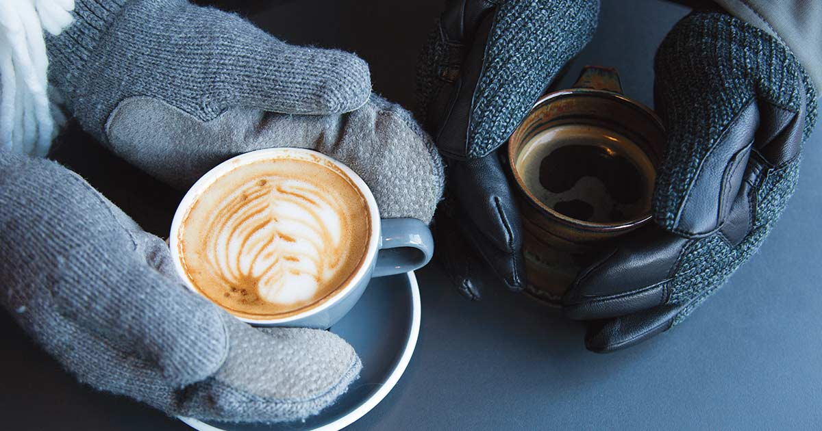 Gloved hands holding lattes