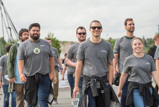 Group of people walking in Nutrien shirts