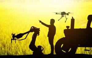 Silhouette of farmer and farming technologies