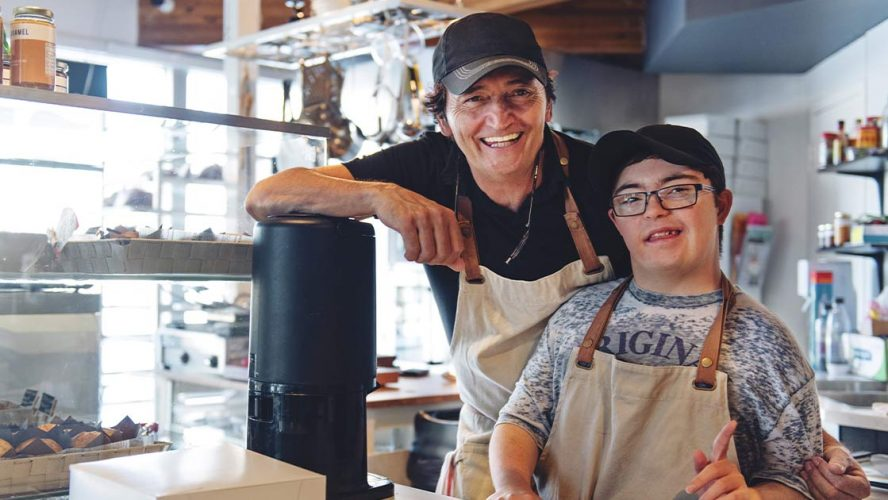 Two men who own a small business, one has Down syndrome
