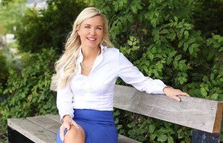 Debby Carreau sitting on a bench