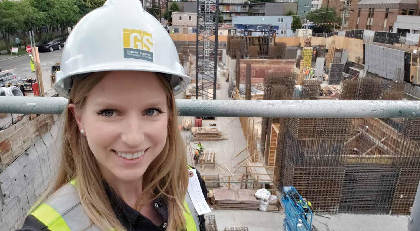Kelsie Priest smiling in front of a construction site