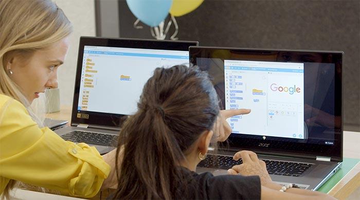 Lauren Howe helping a peer in class