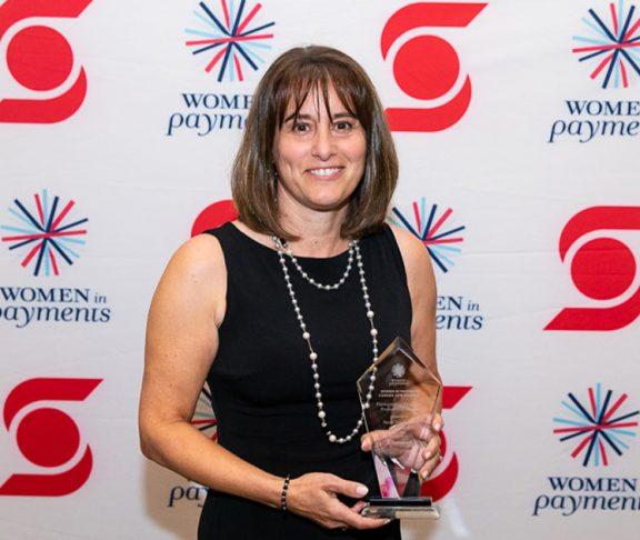 Suzan Denoncourt holding an award