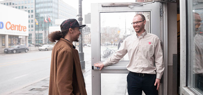 Employee welcomes a neighbour in need to Salvation Army shelter