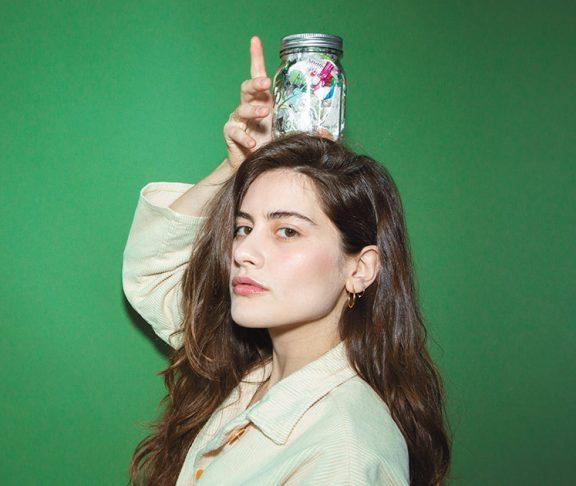 Lauren Singer posing with a mason jar on her head