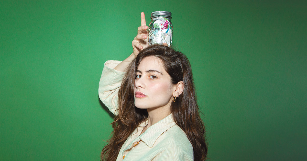 Lauren Singer posing with a mason jar on her head