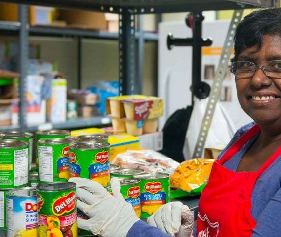 Salvation Army volunteer working in a food pantry