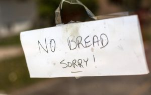 Sign on door that says no bread sorry