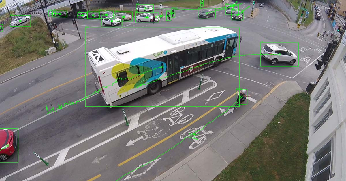 A bus in traffic overlaid with lines signifying vehicles and routes