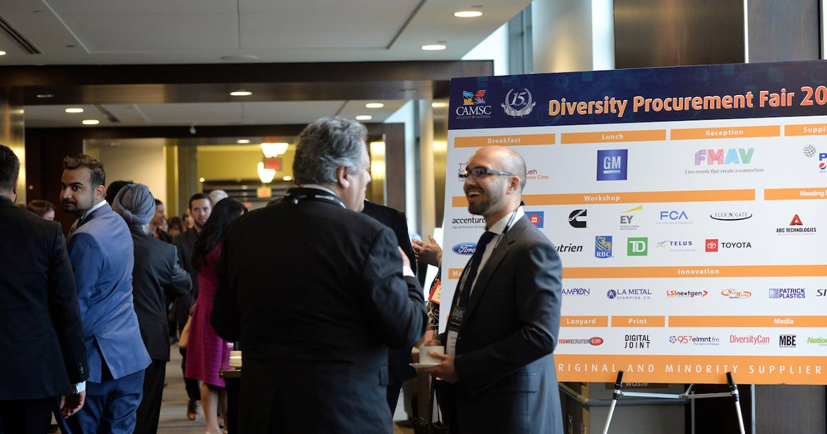 Attendees at a Diversity Procurement Fair having a chat
