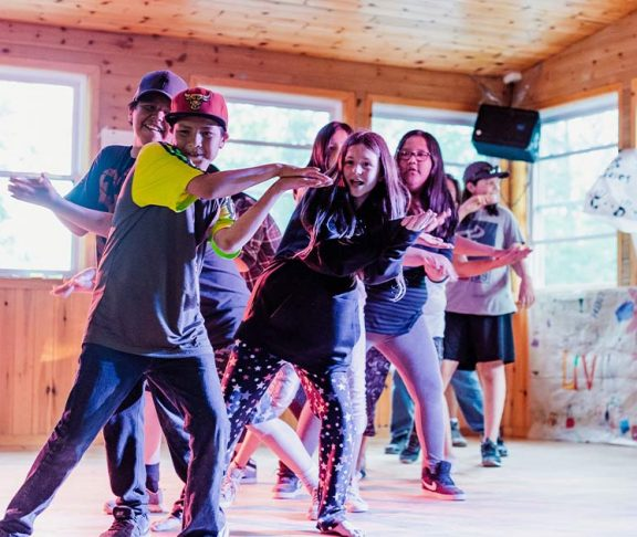 Children dancing at the Right To Play Haliburton Youth Camp