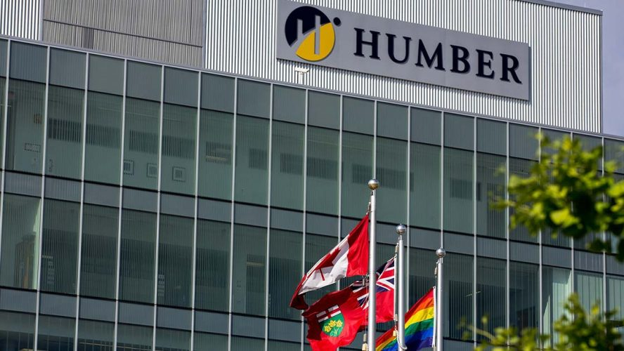 Humber College building with Canadian, Ontario, and Pride flags