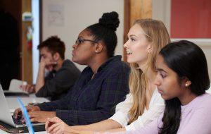 Lauren Howe working on a laptop in class