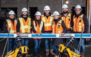 Pomerleau construction crew smiling