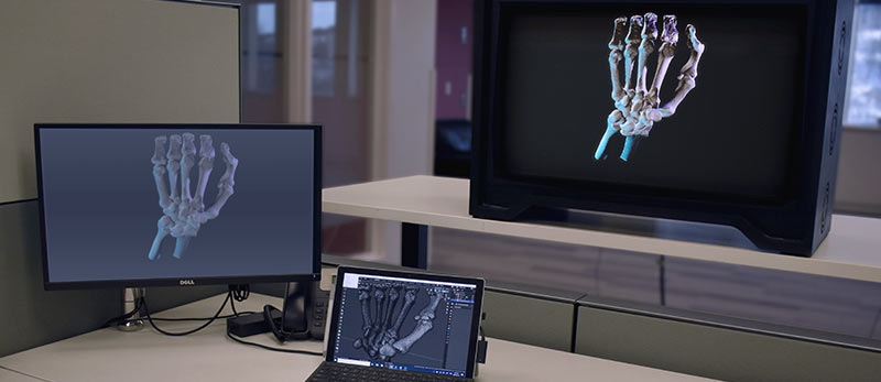 Skelton hand holographic image on three different screens
