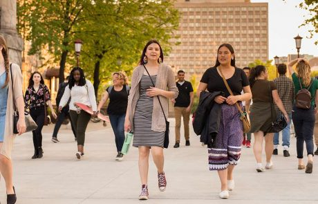 Two Indigenous students walking along the uOttawa campus
