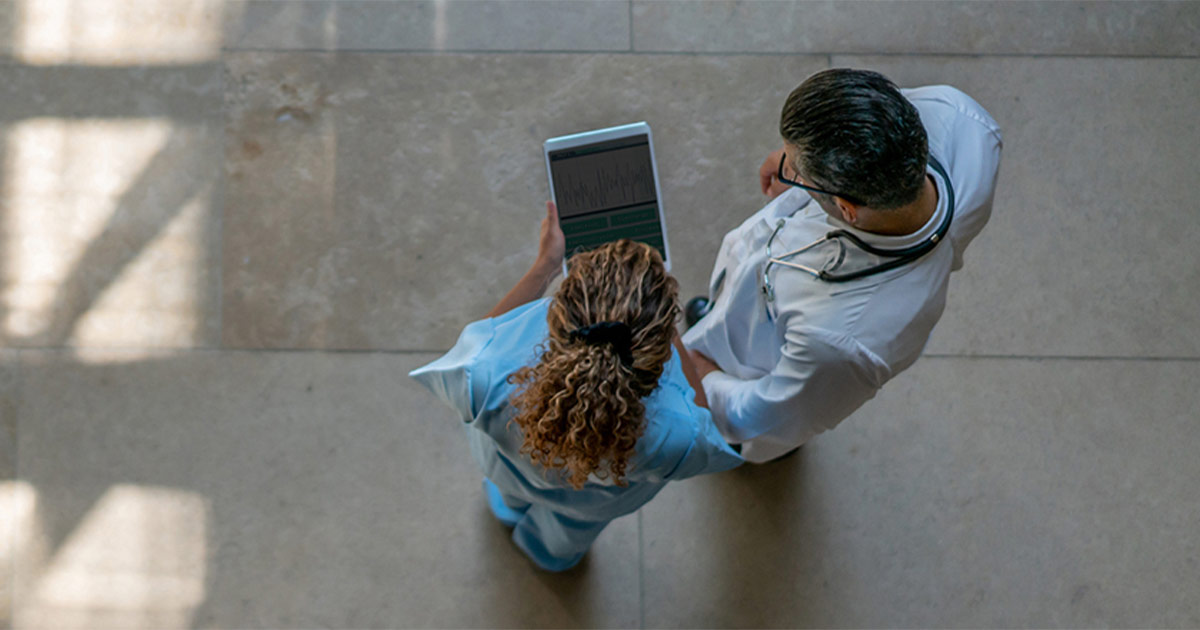 Two doctors looking at a digital tablet