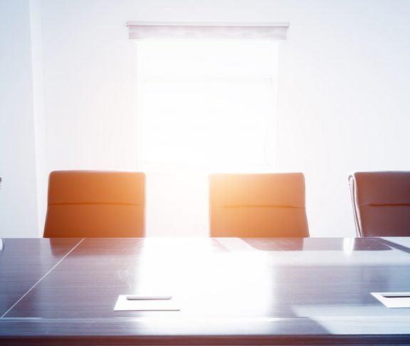 Empty chairs in a corporate board room
