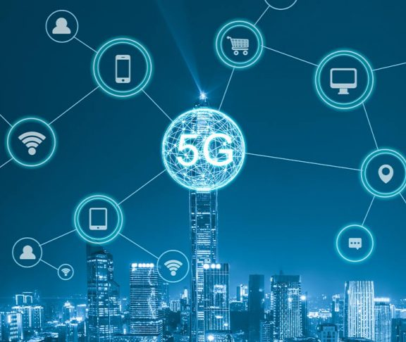 Bubbles above a city skyline with various 5G-related icons inside