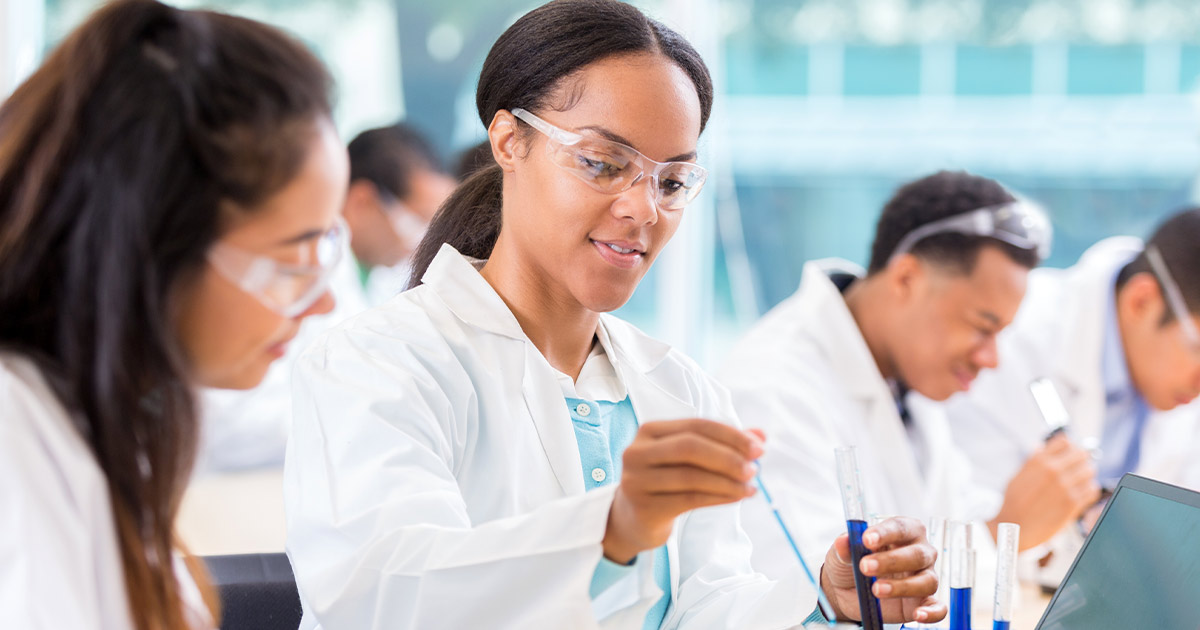 Chemists working on a project in a lab together