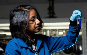 Female scientist inspecting vials of fluid